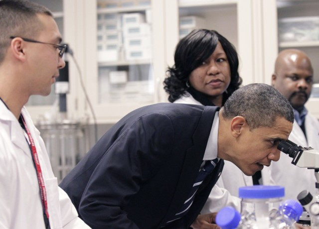President Barack Obama looks through a microscope during his tour the Bio-technology program at Forsyth Tech Community College in Winston-Salem, N.C., Monday, Dec. 6, 2010. (AP Photo/Pablo Martinez Monsivais)
