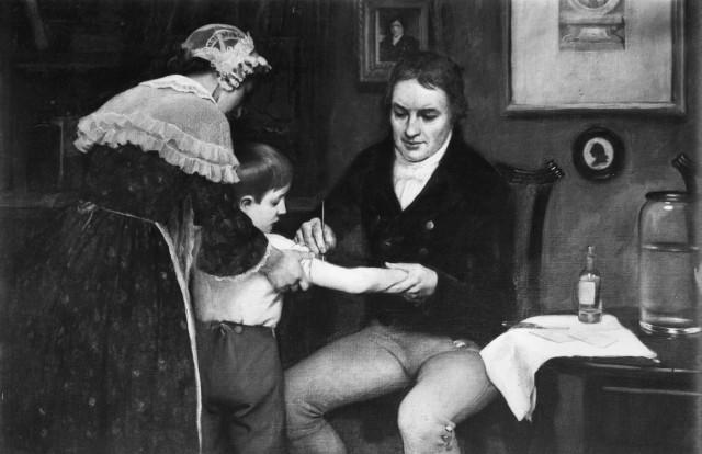 Cuadro de Ernest Board que representa a Edward Jenner inoculando la viruela a James Phipps.